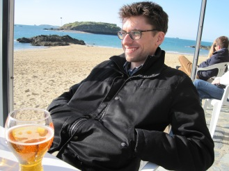 An orange cold beer on a cold day in St. Malo