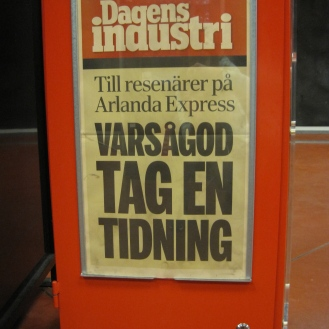 Red Newspaper stand in front of Arlanda Express (the fastest way from the airport to the city!)