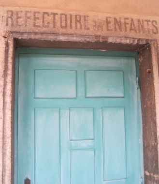Teal door at L'Ancien Couvent des Bernardines, a medieval nunnery