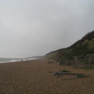 A view down the beach at Dunwich, you can see the cliff edges where there's no more town. You can even here the ghosts from the sea, spooky!
