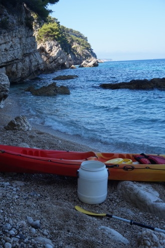 red, orange, and YELLOW kayak on a secluded beach