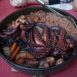 Octopus cooked under a domed lid, specialty dish