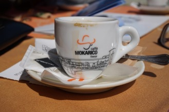 Daily espressos on an orange table